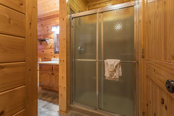 Bathroom with a walk-in shower at Grand Timber Lodge, a 5-bedroom cabin rental located in Pigeon Forge