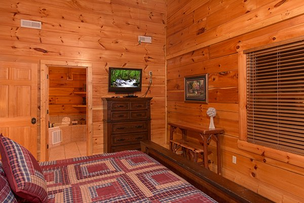 Bedroom in the loft with a television and dresser at Bearfoot Paradise, a 3-bedroom cabin rental located in Pigeon Forge
