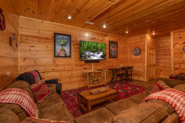 Media room with large sectional sofa at Bearfoot Paradise, a 3 bedroom cabin rental in Pigeon Forge