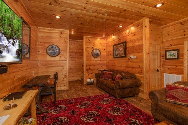 Media room with seating and a writing desk at Bearfoot Paradise, a 3 bedroom cabin rental in Pigeon Forge