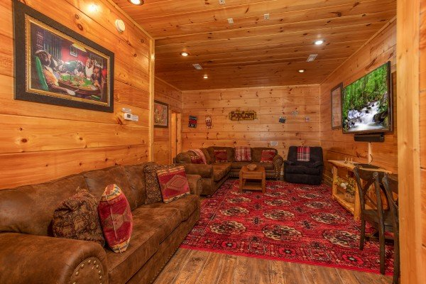 Sleeper sofa and writing desk in the media room at Bearfoot Paradise, a 3 bedroom cabin rental in Pigeon Forge