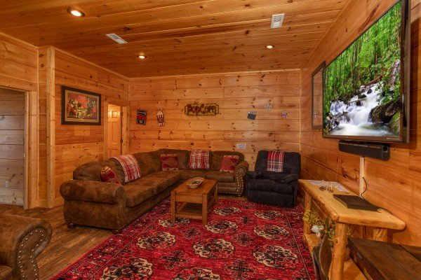 Large sectional sofa and TV in the media room at Bearfoot Paradise, a 3 bedroom cabin rental in Pigeon Forge