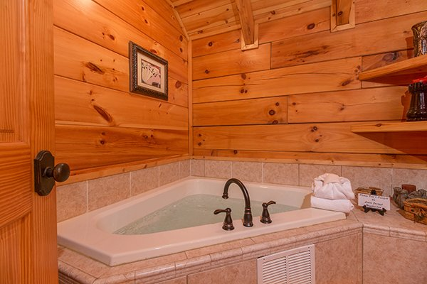 Corner jacuzzi tub in the bathroom at Bearfoot Paradise, a 3-bedroom cabin rental located in Pigeon Forge