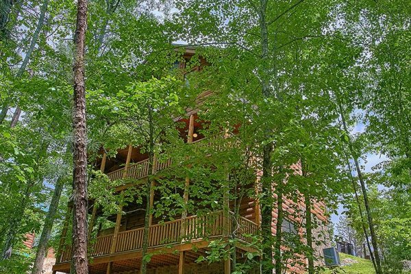 Wooded exterior view looking up at the cabin at Bearfoot Paradise, a 3-bedroom cabin rental located in Pigeon Forge