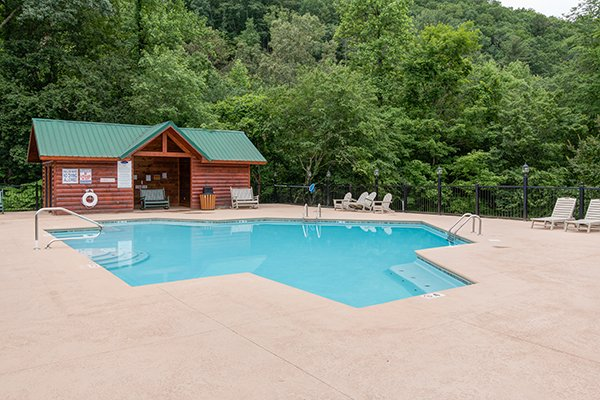 Pool and outbuilding at Bearfoot Paradise, a 3-bedroom cabin rental located in Pigeon Forge