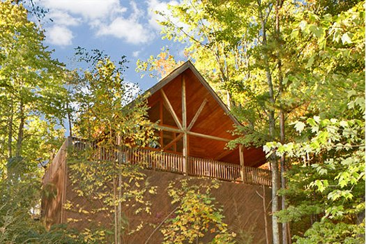 exterior view of a log cabin named almost heaven a 1 bedroom cabin rental located in pigeon forge