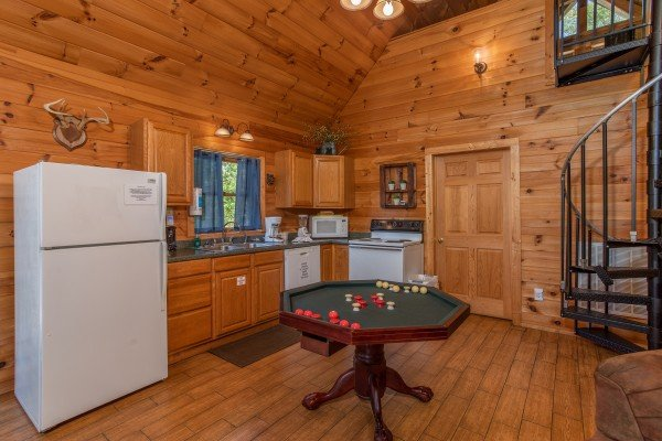 convertible dining table to bumper pool table at almost heaven a 1 bedroom cabin rental located in pigeon forge