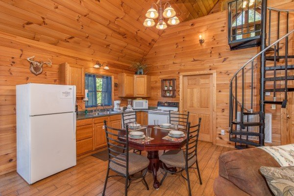 dining room with seating for four in the kitchen at almost heaven a 1 bedroom cabin rental located in pigeon forge