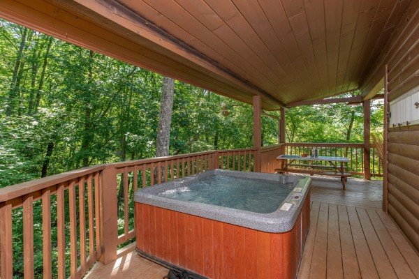 hot tub on a covered deck at almost heaven a 1 bedroom cabin rental located in pigeon forge