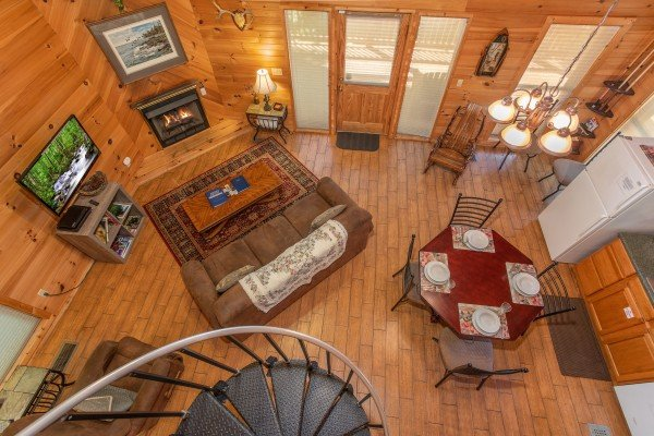 overhead view of the living space and spiral staircase at almost heaven a 1 bedroom cabin rental located in pigeon forge