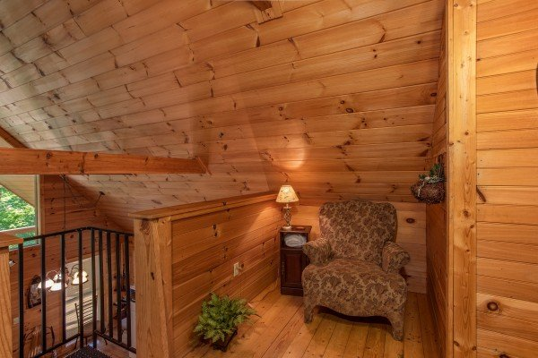 chair in a reading nook in the loft at almost heaven a 1 bedroom cabin rental located in pigeon forge