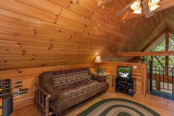twin bed with a television in the loft at almost heaven a 1 bedroom cabin rental located in pigeon forge