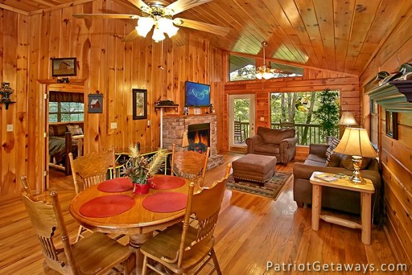 dining room table with seating for four at always together forever a 1 bedroom cabin rental located in pigeon forge
