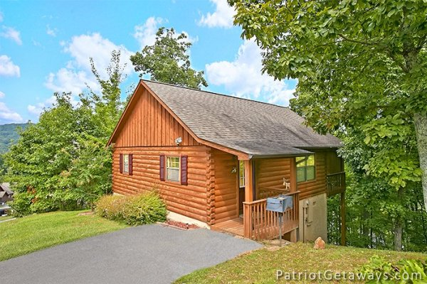 cabin exterior view with flat parking at always together forever a 1 bedroom cabin rental located in pigeon forge