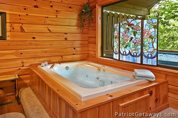 jacuzzi tub in master bedroom at always together forever a 1 bedroom cabin rental located in pigeon forge