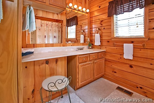 bathroom with vanity and sink at always together forever a 1 bedroom cabin rental located in pigeon forge