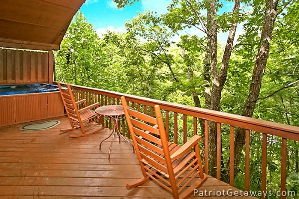 rocking chairs on the covered deck at always together forever a 1 bedroom cabin rental located in pigeon forge