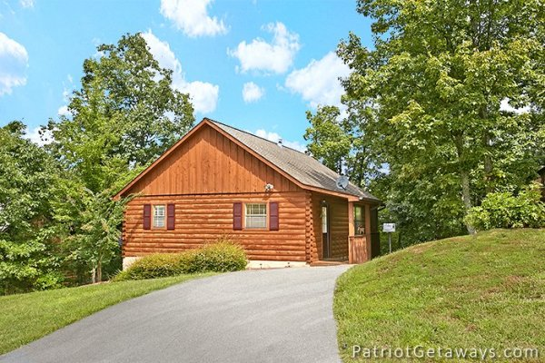 side exterior view with parking at always together forever a 1 bedroom cabin rental located in pigeon forge