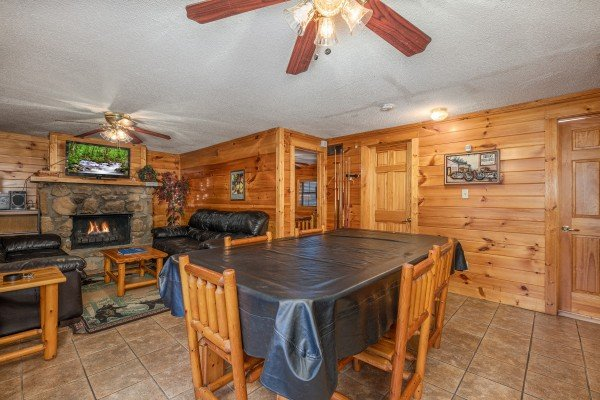 Pool table in the dining space at Pine Splendor, a 5 bedroom cabin rental located in Pigeon Forge
