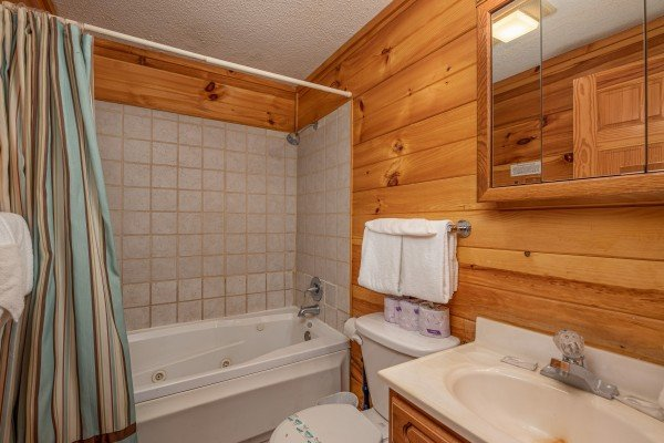 Bathroom with a tub and shower at Pine Splendor, a 5 bedroom cabin rental located in Pigeon Forge