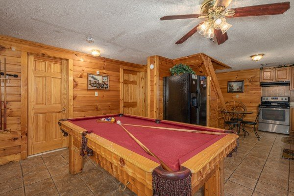 Red felt pool table at Pine Splendor, a 5 bedroom cabin rental located in Pigeon Forge