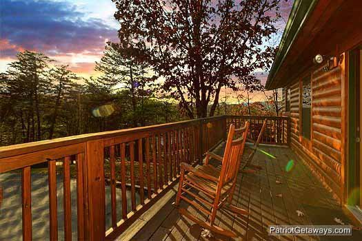 Rear deck with rocking chairs at Pine Splendor, a 5 bedroom cabin rental located in Pigeon Forge