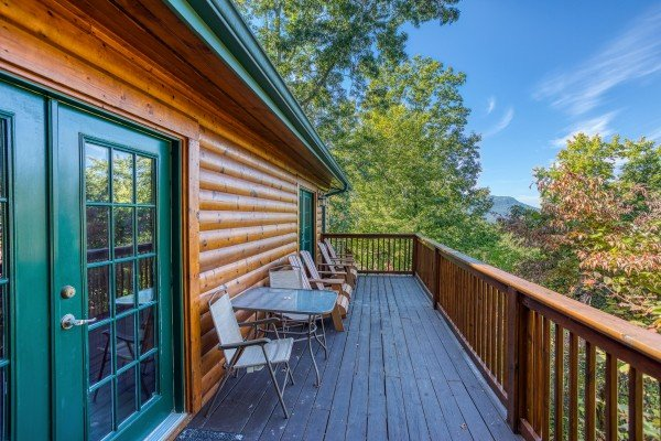 Deck on the second level at Pine Splendor, a 5 bedroom cabin rental located in Pigeon Forge