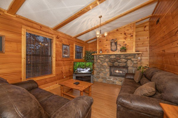Second living room with fireplace & tv at Pine Splendor, a 5 bedroom cabin rental located in Pigeon Forge