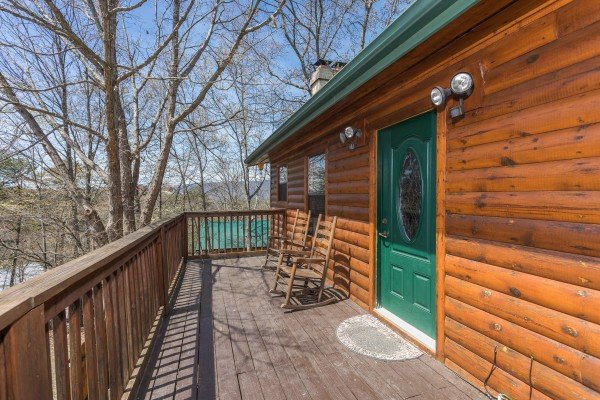 Second floor deck with wooded surrounding at Pine Splendor, a 5 bedroom cabin rental located in Pigeon Forge