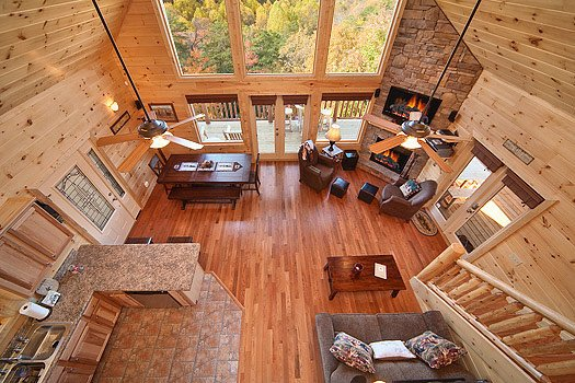 living room view from the loft at horse'n around a 3 bedroom cabin rental located in pigeon forge