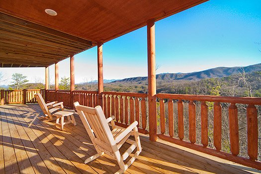 rockers facing the smoky mountains on the deck of horse'n around a 3 bedroom cabin rental located in pigeon forge