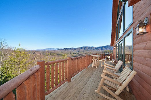 rockers on the deck facing the smoky mountains at horse'n around a 3 bedroom cabin rental located in pigeon forge