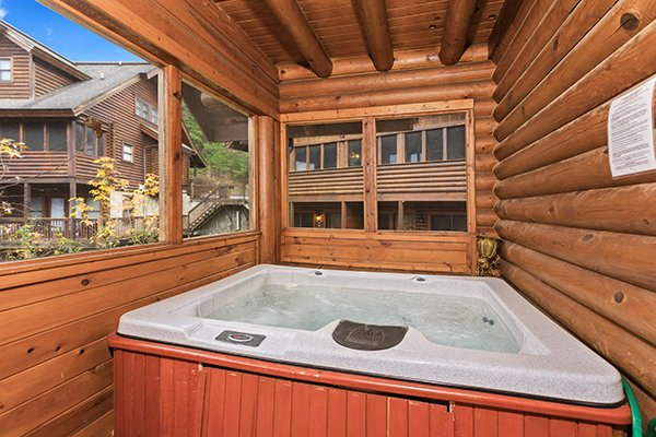 Hot tub on a screened deck at Starry Starry Night #725, a 2 bedroom cabin rental located in Pigeon Forge