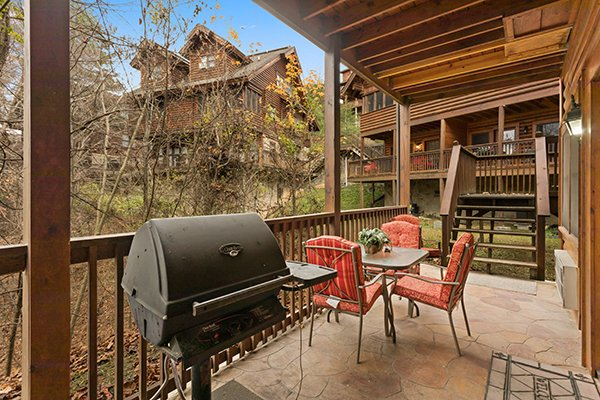 Patio with a grill and dining set at Starry Starry Night #725, a 2 bedroom cabin rental located in Pigeon Forge