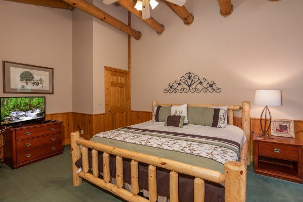 King log bed with dresser and TV at Starry Starry Night #725, a 2 bedroom cabin rental located in Pigeon Forge
