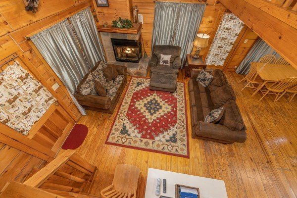 Looking down at the living room from the loft at Fox Ridge, a 3 bedroom cabin rental located in Pigeon Forge