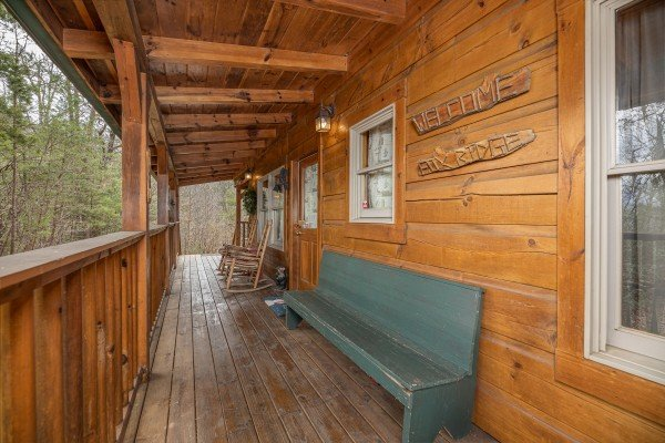 Bench on the deck at Fox Ridge, a 3 bedroom cabin rental located in Pigeon Forge