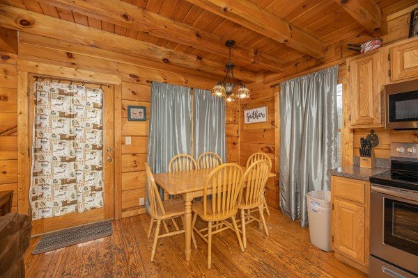Dining table for six at Fox Ridge, a 3 bedroom cabin rental located in Pigeon Forge