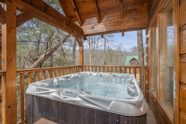 Hot tub on the loft deck at Fox Ridge, a 3 bedroom cabin rental located in Pigeon Forge