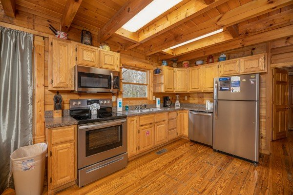 Kitchen with stainless appliances at Fox Ridge, a 3 bedroom cabin rental located in Pigeon Forge