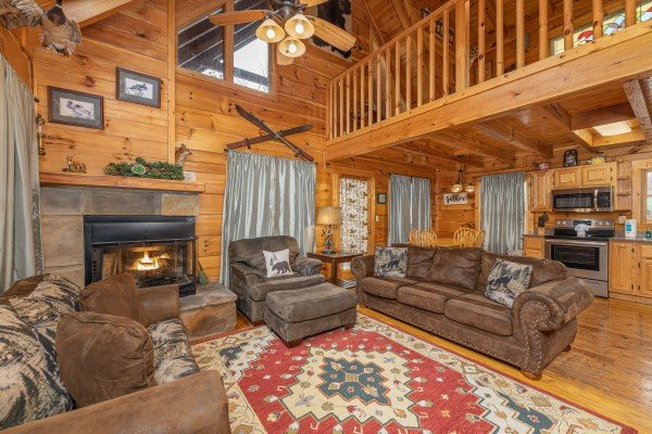 Vaulted living room with a fireplace, sofa, loveseat, and chaise at Fox Ridge, a 3 bedroom cabin rental located in Pigeon Forge