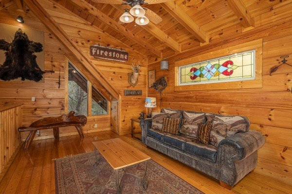 Loft with sofa at Fox Ridge, a 3 bedroom cabin rental located in Pigeon Forge