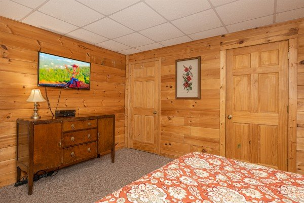 Dresser and TV in a bedroom at Fox Ridge, a 3 bedroom cabin rental located in Pigeon Forge