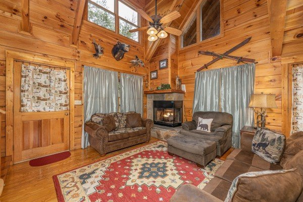 Vaulted living room with a fireplace at Fox Ridge, a 3 bedroom cabin rental located in Pigeon Forge