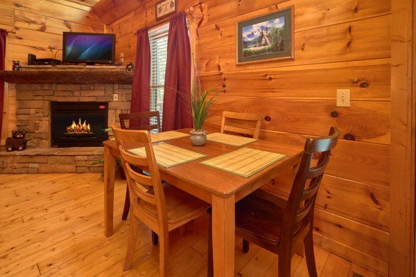 Dining table for four at Pop's Snuggle Bear, a 1 bedroom cabin rental located in Pigeon Forge