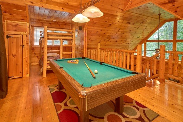 Pool table in the loft at Pop's Snuggle Bear, a 1 bedroom cabin rental located in Pigeon Forge