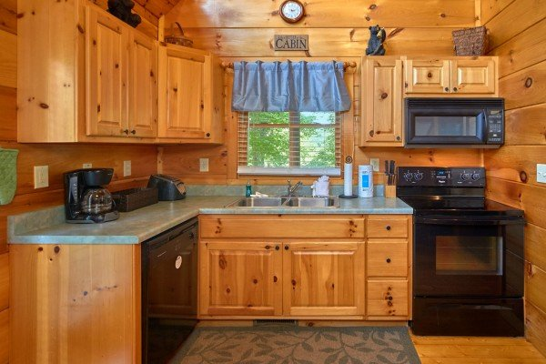 Kitchen with black appliances at Pop's Snuggle Bear, a 1 bedroom cabin rental located in Pigeon Forge