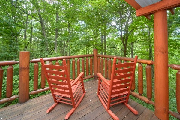 Rocking chairs with a wooded view at Pop's Snuggle Bear, a 1 bedroom cabin rental located in Pigeon Forge