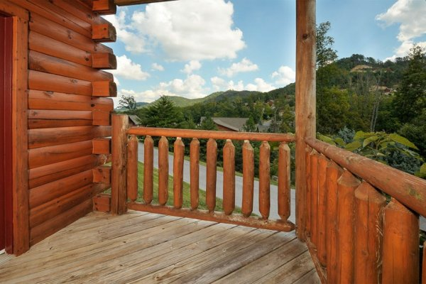 Looking out onto the road from the deck at Kick Back & Relax! A 4 bedroom cabin rental located in Pigeon Forge