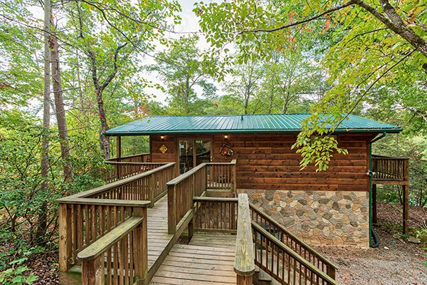 Parking area and the deck entryway at Bird's Eye View, a 2-bedroom cabin rental located in Gatlinburg